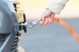 Hand holding tow rope